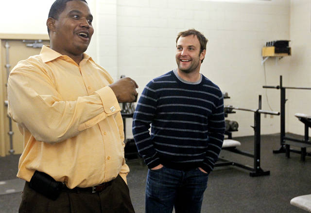 OKC native and NFL receiver Wes Welker tours Douglass High School with football coach Willis Alexander on Tuesday, Feb. 28, 2012 in Oklahoma City, Okla. Douglass is one of three schools to receive grants from Welker's foundation, the WW Foundation, that help improve athletic possibilities for at-risk youth. Photo by Chris Landsberger, The Oklahoman