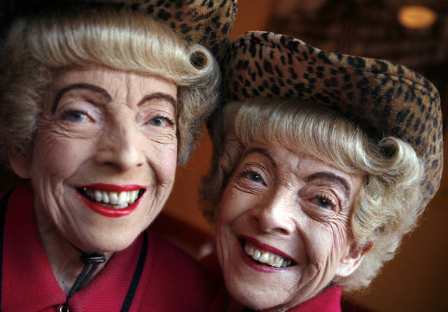 This Sept. 22, 2008, photo shows twins Marian, left, and Vivian Brown at Uncle Vito's in San Francisco. San Francisco residents are mourning the passing of Vivian Brown, who along with her twin sisters, became a local celebrity by walking through the city's streets in matching high-end outfits, identical hairdos and cheerful smiles. The 85-year-old Brown died in her sleep on Wednesday, Jan. 9, 2013, at an assisted care facility in the city, Barbara Farber, director of development for Jewish Family and Children's Services, told the San Francisco Chronicle. (AP Photo/San Francisco Chronicle, Mike Kepka)  NORTHERN CALIFORNIA MANDATORY CREDIT PHOTOG & CHRONICLE; MAGS OUT; NO SALES; TV OUT