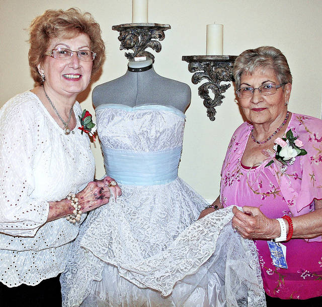 Josie Codispoti, left, and Flo Owens show a 1959 prom dress worn by Judith  Harris. The dress was on display at a senior prom at Touchmark at Coffee Creek.   PHOTOs PROVIDED BY TOUCHMARK AT COFFEE CREEK