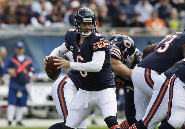 Chicago Bears quarterback Jay Cutler (6) prepares to pass to a receiver against the St. Louis Rams in the first half of an NFL football game in Chicago, Sunday, Sept. 23, 2012. (AP Photo/Nam Y. Huh)
