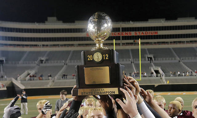 CLASS 6A HIGH SCHOOL FOOTBALL STATE CHAMPIONSHIP GAME: Jenks' Trey'Vonne Barr'e hoist the championship trophy after the Trojans defeated Norman North in the Class 6A Oklahoma state championship football game between Norman North High School and Jenks High School at Boone Pickens Stadium on Friday, Nov. 30, 2012, in Stillwater, Okla.   Photo by Chris Landsberger, The Oklahoman