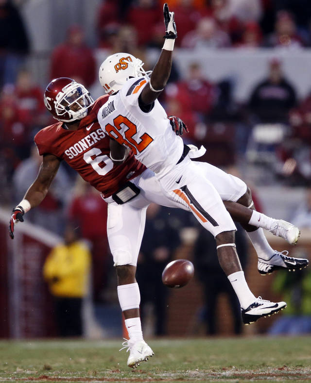 Oklahoma's Demontre Hurst (6) breaks up a pass intended for Oklahoma State's Isaiah Anderson (82) during the second half of the Bedlam college football game in which  the University of Oklahoma Sooners (OU) defeated the Oklahoma State University Cowboys (OSU) 51-48 in overtime at Gaylord Family-Oklahoma Memorial Stadium in Norman, Okla., Saturday, Nov. 24, 2012. Photo by Steve Sisney, The Oklahoman