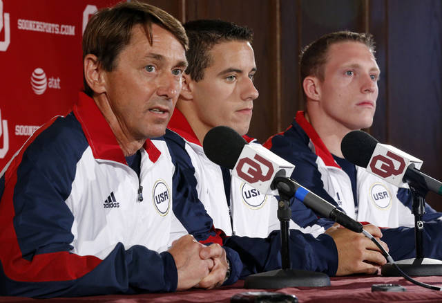OU gymnastics coach Mark Williams, left, has guided a program that has produced Olympians like Jake Dalton, center, and Steven Legendre, right. Photo by Steve Sisney, The Oklahoman