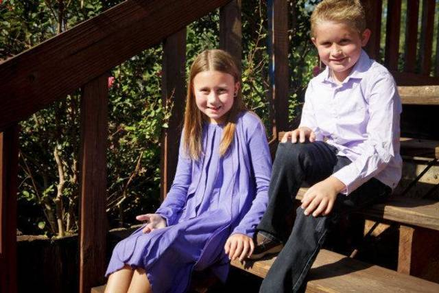 Gracie G. and Ben M. sit on the steps of a pavillion at Hafer Park in Edmond. Rose Bud Dress by Lemon Loves Lime, long-sleeve lilac dress shirt by Scotch Shrunk and denim jeans by Alphabet, all from LadyBugs and Lizards. <strong>ZACH GRAY</strong>
