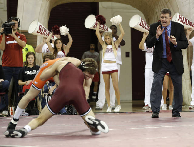 OU head coach Mark Cody yells from the bench as OU's Kyle Garcia wrestles OSU's Tyler Dorrell during the wrestling match between Oklahoma University and Oklahoma State University at McCasland Field House in Norman, Okla.,Sunday, Dec. 9, 2012.  Photo by Garett Fisbeck, For The Oklahoman