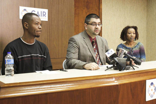 Adam Soltani, center, Oklahoma executive director for a Muslim civil-rights group, Saadiq Long, a Muslim man who recently returned to Oklahoma from the Middle East, and Long's sister, Ava Anderson, appear at a news conference Thursday.  Photo by Paul Hellstern, The Oklahoman