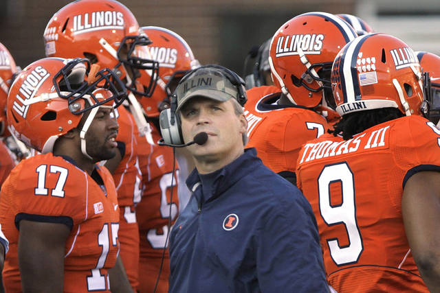 In this Nov. 10, 2012 photo, Illinois head coach Tim Beckman looks at the clock during a time out during the first half of an NCAA college football game between Illinois and Minnesota in Champaign, Ill. The Illini are the only Big Ten team without a conference win this season. Purdue plays at Illinois this Saturday, Nov. 17.(AP Photo/Seth Perlman)