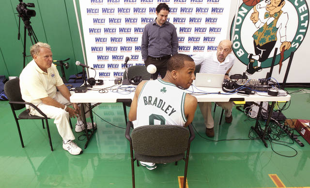 Boston Celtic guard Avery Bradley (0) takes a break from a radio interview during media day at the NBA basketball team's training center in Waltham, Mass., Friday, Sept. 28, 2012. (AP Photo/Stephan Savoia)
