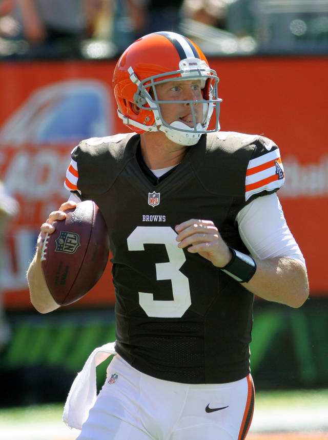FILE - This Sept. 16, 2012 file photo shows Cleveland Browns quarterback Brandon Weeden in action against the Cincinnati Bengals in an NFL football game in Cincinnati. One week after his dismal NFL debut, Weeden dazzled. In Sunday's 34-27 loss at Cincinnati, Cleveland's rookie quarterback was accurate, decisive and cool under pressure. (AP Photo/Tom Uhlman, File)