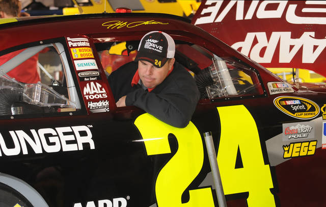 Jeff Gordon's car chief, Josh Kirk, pauses while working on the (24) car in the garage at the Martinsville Speedway, before NASCAR's Goody's Fast Relief 500 auto race, Sunday, April 1, 2012, in Martinsville, Va. (AP Photo Don Petersen)