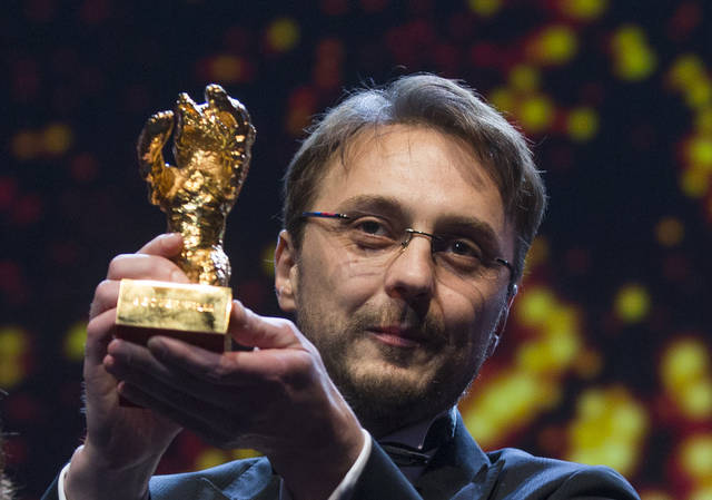 Director Calin Peter Netzer holds the Golden Bear for his film Child's Pose at the closing ceremony at the 63rd edition of the Berlinale, International Film Festival in Berlin, Saturday, Feb. 16, 2013. (AP Photo/Gero Breloer)