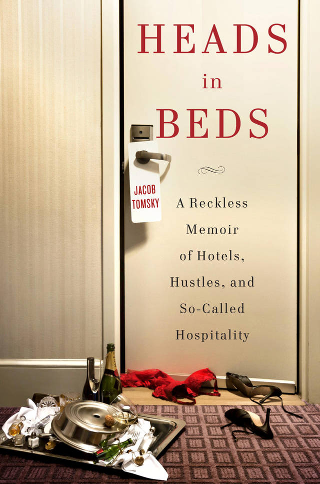 "This book cover image released by Doubleday shows ""Heads in Beds: A Reckless Memoir of Hotels, Hustles, and So-Called Hospitality. (AP Photo/Doubleday)"