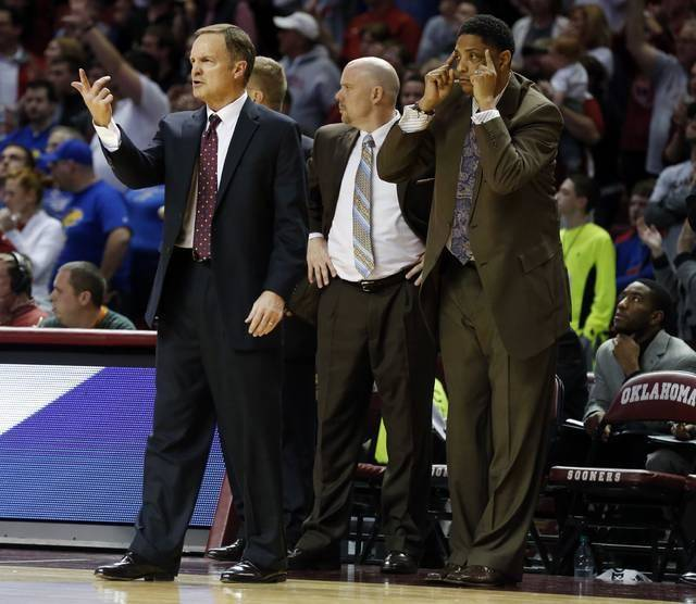 Oklahoma head coach Lon Krueger gestures to the team during the second half as the University of Oklahoma Sooners (OU) defeat the Kansas Jayhawks (KU) 72-66 in NCAA, men's college basketball at The Lloyd Noble Center on Saturday, Feb. 9, 2013 in Norman, Okla. Beside him are assistanty coaches Steve Henson, center, and Lew Hill. Photo by Steve Sisney, The Oklahoman