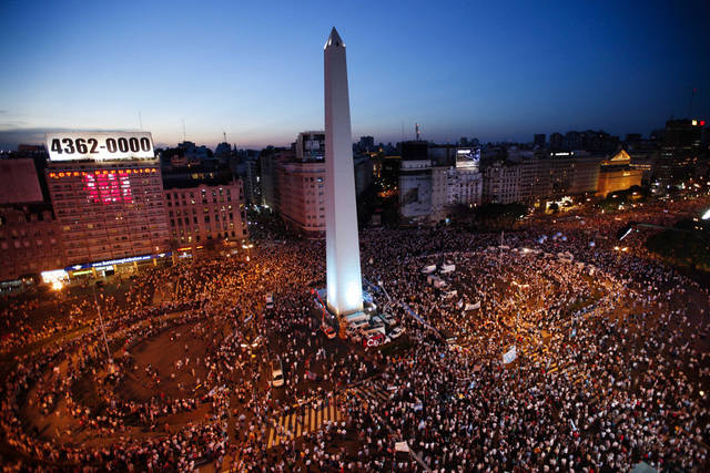 Protesters demonstrate during a march against Argentina's President Cristina Fernandez in Buenos Aires, Argentina, Thursday, Nov. 8, 2012. Angered by rising inflation, violent crime and high-profile corruption, and afraid Fernandez will try to hold onto power indefinitely by ending constitutional term limits, the protesters banged pots and marched on the iconic obelisk in Argentina's capital. Protests also were held in plazas nationwide and outside Argentine embassies and consulates around the world. (AP Photo/Natacha Pisarenko)