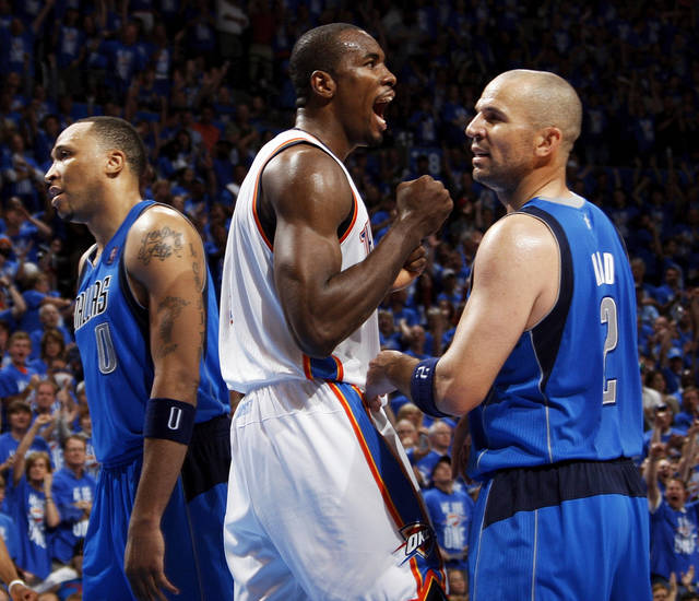 Oklahoma City's Serge Ibaka (9) celebrates between Dallas' Shawn Marion (0), left, and Jason Kidd (2) during game one of the first round in the NBA playoffs between the Oklahoma City Thunder and the Dallas Mavericks at Chesapeake Energy Arena in Oklahoma City, Saturday, April 28, 2012. Oklahoma City won, 99-98. Photo by Nate Billings, The Oklahoman