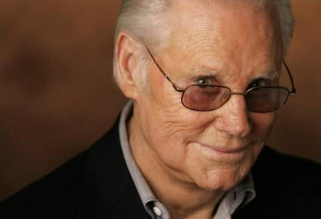 "In this Jan. 10, 2007 file photo, George Jones is shown in Nashville, Tenn. Jones, the peerless, hard-living country singer who recorded dozens of hits about good times and regrets and peaked with the heartbreaking classic ""He Stopped Loving Her Today,"" has died. He was 81. Jones died Friday, April 26, 2013 at Vanderbilt University Medical Center in Nashville after being hospitalized with fever and irregular blood pressure, according to his publicist Kirt Webster. (AP)"