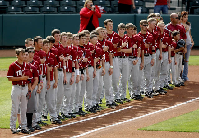 The Tuttle baseball team stands during the national anthem before the start of their high school baseball game against Comanche at RedHawks Field at Bricktown in Oklahoma City, Tuesday, March 27, 2012. Photo by Bryan Terry
