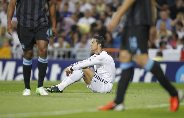 Real Madrid's Cristiano Ronaldo from Portugal reacts during a Group D Champions League soccer match against Manchester City at the Santiago Bernabeu stadium in Madrid Tuesday Sept. 18, 2012. (AP Photo/Paul White)