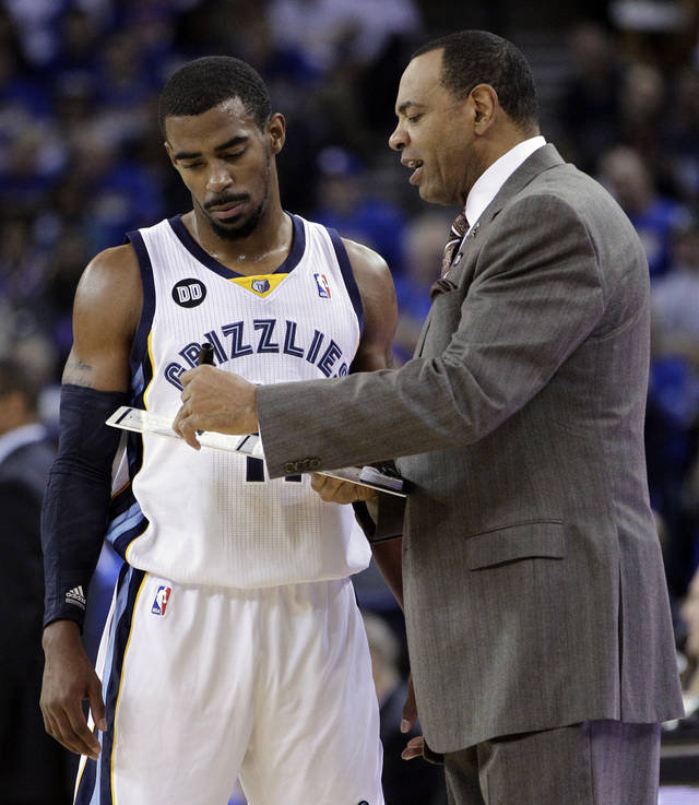 Memphis Grizzlies' Mike Conley, left, speaks with coach Lionel Hollins during the first half of an NBA basketball game against the Golden State Warriors Friday, Nov. 2, 2012, in Oakland, Calif. (AP Photo/Ben Margot)