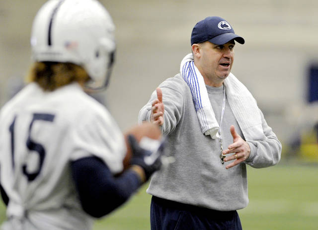 Penn State head coach Bill O'Brien talks to Alex Kenney and other wide receivers as they run a drill during the team's first day of NCAA college football spring practice on Monday, March 18, 2013, in State College, Pa. (AP Photo/Centre Daily Times, Abby Drey) MANDATORY CREDIT; MAGS OUT