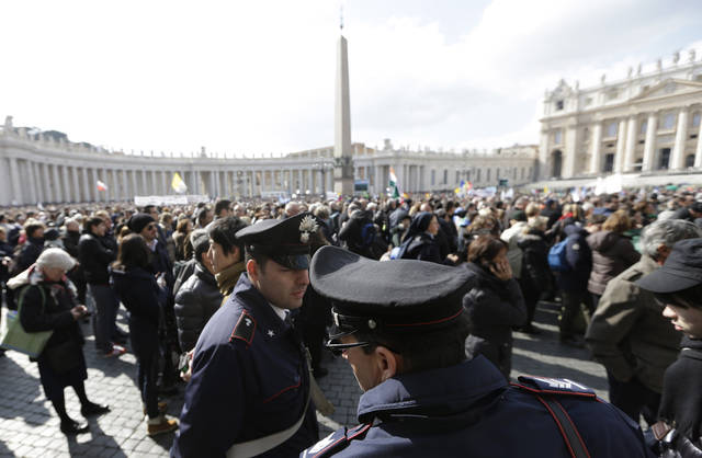 FILE -- In this file photo taken on Feb. 24, 2013, policeman patrol as faithful gather the last Angelus noon prayer of Pope Benedict XVI, celebrated from the window of his studio overlooking St. Peter's square at the Vatican. Planning for the moment when the next pope is proclaimed to the world, and for the installation ceremony a few days later, is a big-time guessing game. And that adds up to an ungodly logistical headache for the city of Rome. Nearly everything went smoothly for Benedict�s last public appearances, although some faithful panicked during the retired pope�s penultimate Sunday blessing from his studio window, when thousands of last-minute arrivals tried to squeeze through three narrow openings through a metal fence ringing the edge of the square. (AP Photo/Alessandra Tarantino)