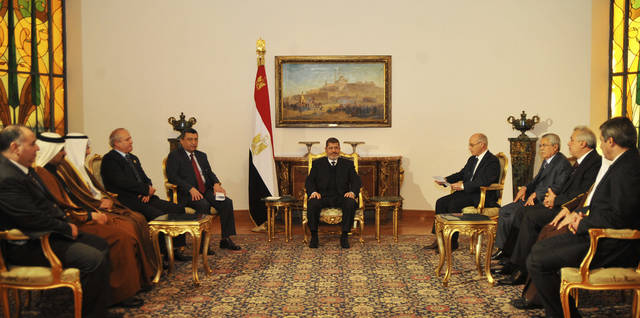 In this image released by the Egyptian Presidency, President Mohammed Morsi, center, meets with members of the Organization of Arab Petroleum Exporting Countries (OAPEC) in Cairo, Egypt, Saturday, Dec. 22, 2012. (AP Photo/Egyptian Presidency)