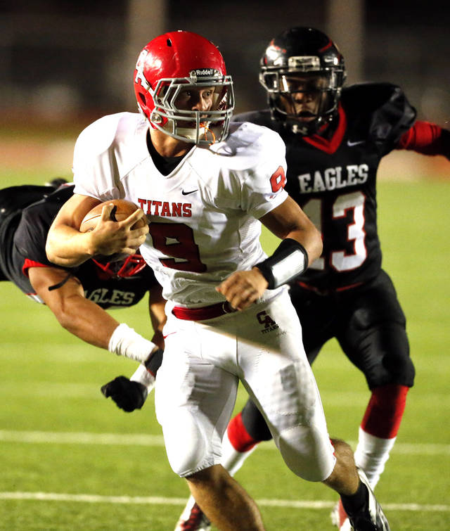 Carl Albert quarterback Toney Caleb makes a long gain chased by Del City Eagles Players Bryson Parker, left, and Shawn Epps in Class 5A, first round, playoff action in high school football on Friday, Nov. 9, 2012 in Del City, Okla.   Photo by Steve Sisney, The Oklahoman