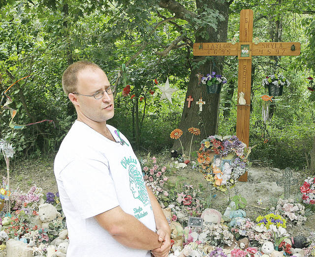 In this 2009 photo, William Whitaker visits the memorial to his daughter Skyla Whitaker and her friend Taylor Paschal-Placker who were murdered on June 8, 2008, near Weleetka.  The Oklahoman archive