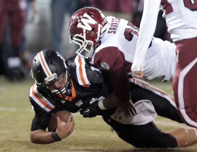 Wynnewood's Miguel Medina (35) brings down Wayne quarterback Sam Martin in high school Football on Friday, Oct. 26, 2012 in Wayne, Okla.  Photo by Steve Sisney, The Oklahoman