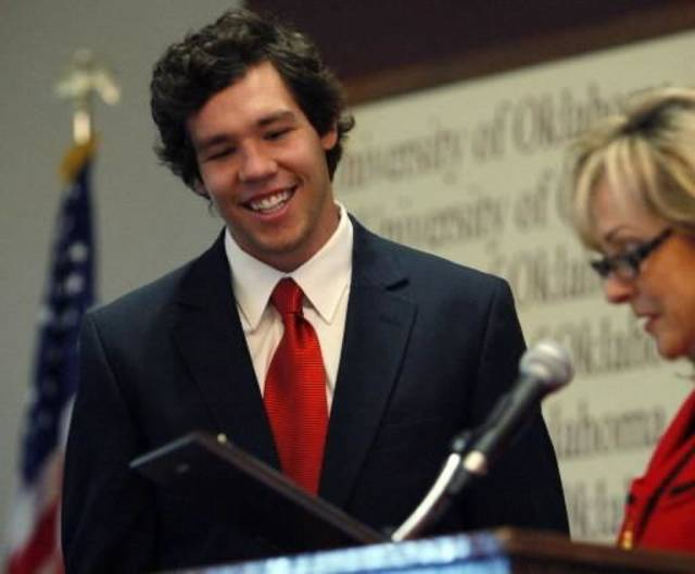 Sooner quarterback  Sam  Bradford is presented with a plaque as congresswoman Mary Fallin reads the resolution passed on the floor of the U.S Congress honoring the Heisman Trophy winner during scholar athlete awards breakfast in the Molly Shi Boren Ballrom at the University of Oklahoma (OU) in Norman, Okla. on Tuesday, April 14, 2009. Photo by Steve Sisney, The Oklahoman