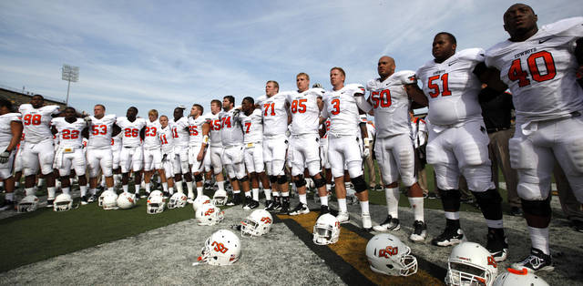 OSU celebrates their win over Missouri during a college football game between the Oklahoma State University Cowboys (OSU) and the University of Missouri Tigers (Mizzou) at Faurot Field in Columbia, Mo., Saturday, Oct. 22, 2011. Photo by Sarah Phipps, The Oklahoman