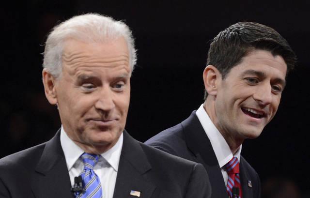 Vice President Joe Biden and Republican vice presidential nominee Rep. Paul Ryan of Wisconsin gesture after the vice presidential debate at Centre College, Thursday, Oct. 11, 2012, in Danville, Ky. (AP Photo/Pool-Michael Reynolds)