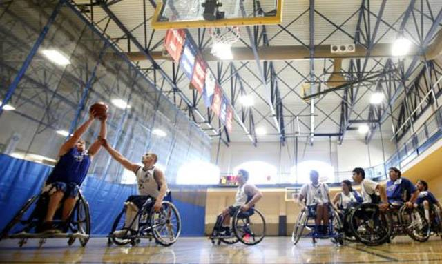Blaze's Dalton Johnson shoots during the National Wheelchair Basketball Association's 2010 Southwest Conference, Saturday, Feb. 27, 2010, at the University of Central Oklahoma Wellness Center, in Edmond, Okla.  Photo by Sarah Phipps, The Oklahoman