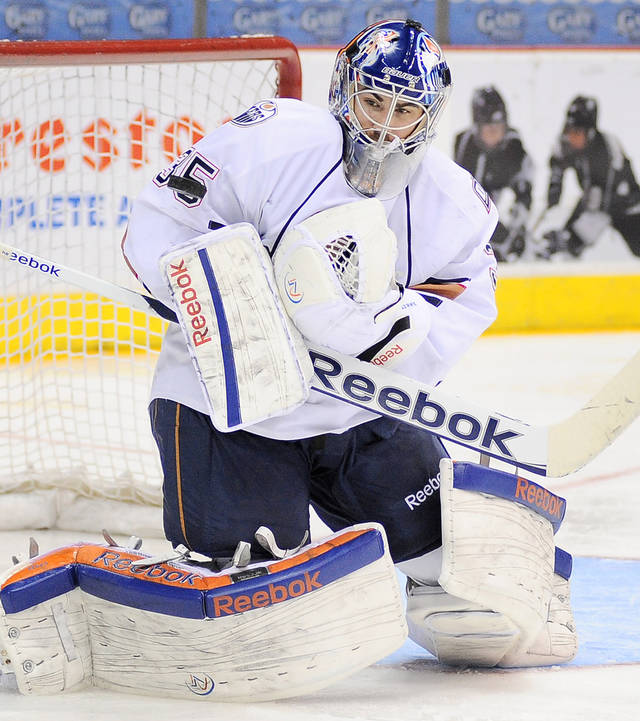 Oklahoma City Barons goaltender Yann Danis makes a save during the second period of an AHL hockey game against the San Antonio Rampage, Sunday, Dec. 9, 2012, in San Antonio. (Darren Abate/pressphotointl.com)