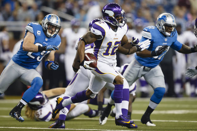 Minnesota Vikings' Percy Harvin returns the opening kickoff for a touchdown during the first quarter of an NFL football game against the Detroit Lions in Detroit, Sunday, Sept. 30, 2012. (AP Photo/Rick Osentoski)
