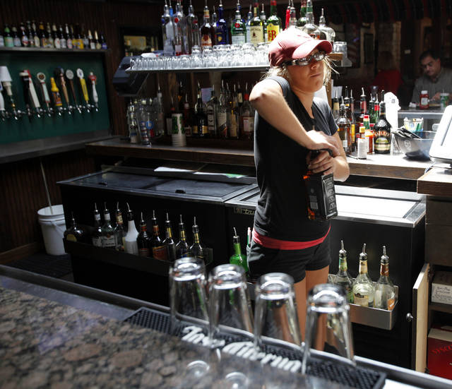 Madison Rial, a University of Oklahoma (OU) student, tends bar at O'Connell's to help pay for her education on Wednesday, July 18, 2012 in Norman, Okla.     Photo by Steve Sisney, The Oklahoman