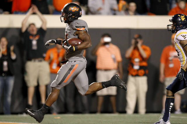 Oklahoma State's Jeremy Smith (31) runs for a touchdown during a college football game between Oklahoma State University (OSU) and West Virginia University at Boone Pickens Stadium in Stillwater, Okla., Saturday, Nov. 10, 2012. Oklahoma State won 55-34. Photo by Bryan Terry, The Oklahoman