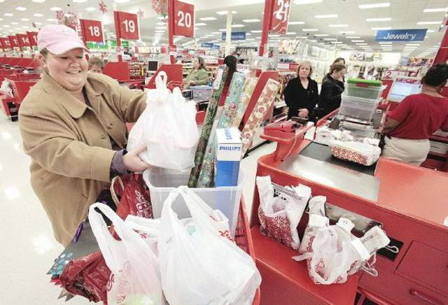 Heidi Hoskinson loads her cart with after Christmas sales items at the Target on Memorial, Monday, December 26, 2011.  Photo by David McDaniel, The Oklahoman  ORG XMIT: KOD