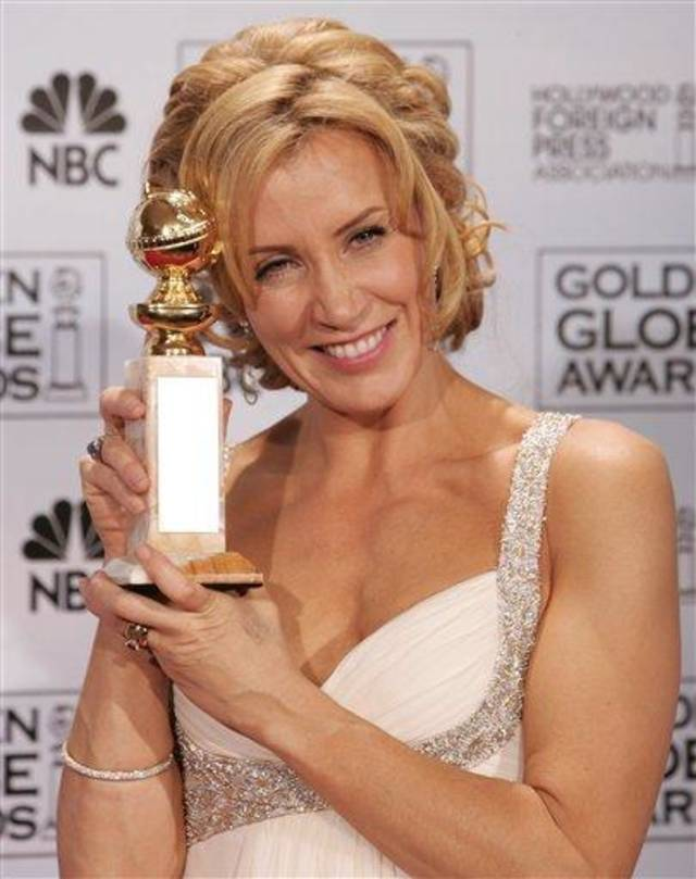 "Felicity Huffman poses with the award she won for best actress in a drama for her work in ""Transamerica,"" at the 63rd Annual Golden Globe Awards on Monday, Jan. 16, 2006, in Beverly Hills, Calif.  (AP Photo/Reed Saxon)"