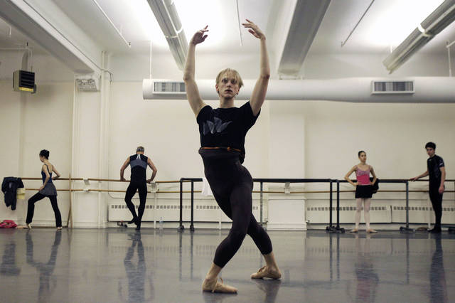 In this Wednesday, Sept. 28, 2011 photo, David Hallberg, 29, regarded as one of the most talented male ballet dancers in the world, practices during a class with American Ballet Theatre dancers in New York. In a reversal of tradition, the young American ballet star will be debuting in Moscow this weekend as a premier dancer with the famed Bolshoi Ballet. Hallberg, who will also remain a principal with the New York based American Ballet Theatre, is the first foreign dancer in the Bolshoi's modern history to be given that distinction. (AP Photo/Kathy Willens)