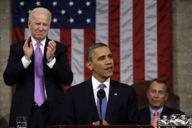 Vice President Joe Biden applauds as President Barack Obama gives his State of the Union address during a joint session of Congress on Capitol Hill in Washington, Tuesday Feb. 12, 2013. House Speaker John Boehner of Ohio sits at right. (AP Photo/Charles Dharapak, Pool) ORG XMIT: CAP517