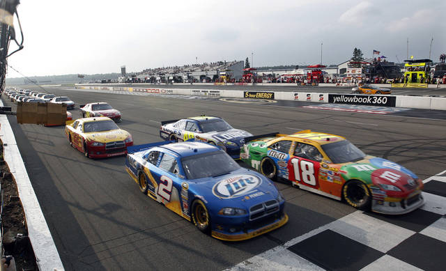 \Brad Keselowski (2) and Kyle Busch (18) are side-by-side on a restart late in the NASCAR Sprint Cup Series auto race Sunday, Aug. 7, 2011, in Long Pond, Pa. Keselowski won and Busch was second. (AP Photo/Mel Evans)