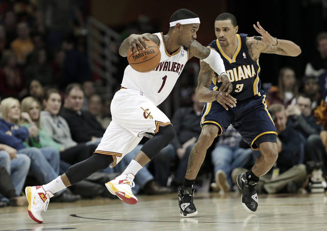 Cleveland Cavaliers' Daniel Gibson (1) drives past Indiana Pacers' George Hill (3) during the fourth quarter in an NBA basketball game on Friday, Dec. 21, 2012, in Cleveland. The Pacers won 99-89. (AP Photo/Tony Dejak)