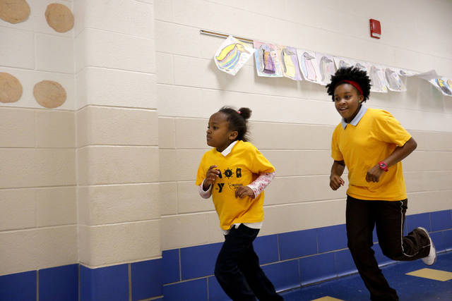 Yasmine Minor, left, and Bryanna Newton are part of the girls running club at their elementary school.