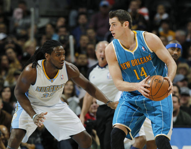 New Orleans Hornets forward Jason Smith, right, looks to pass the ball as Denver Nuggets forward Kenneth Faried covers in the first quarter of an NBA basketball game in Denver, Friday, Feb. 1, 2013. (AP Photo/David Zalubowski)