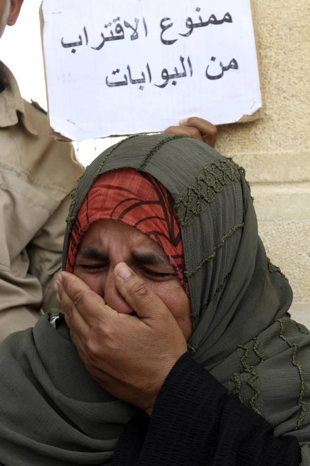 "The mother of Egyptian border policeman Ahmed Abd el-Fadia, who was kidnapped last Thursday in northern Sinai, protests at the Rafah, Sinai, border crossing between Egypt and the Gaza strip, Sunday, May 19, 2013. Rafah, the main crossing point into the Gaza Strip, was closed by policemen Friday, barring people from going in or out of the Palestinian territory. Scores of  protesting Egyptian police have also shut down the Awja commercial border crossing with Israel Sunday. Arabic reads, ""Forbidden to approach."" (AP Photo/Roger Anis, El Shorouk Newspaper) EGYPT OUT"