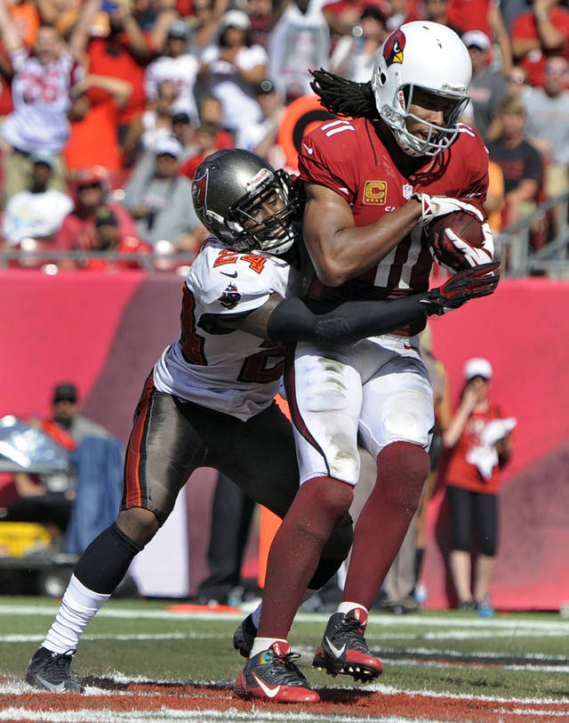 Arizona Cardinals wide receiver Larry Fitzgerald (11) catches a 13-yard touchdown pass after getting past Tampa Bay Buccaneers cornerback Darrelle Revis (24) during the fourth quarter of an NFL football game on Sunday, Sept. 29, 2013, in Tampa, Fla. (AP Photo/Brian Blanco)