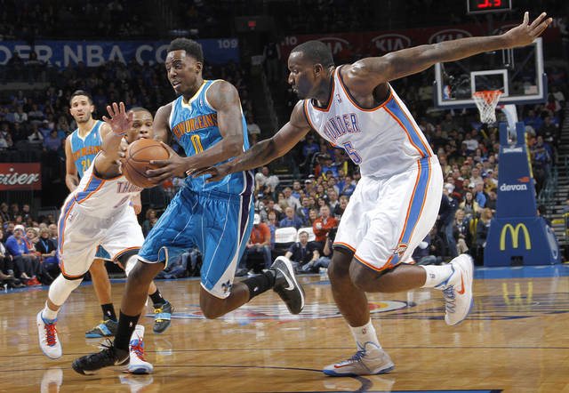 Oklahoma City Thunder's Russell Westbrook (0) and Kendrick Perkins (5) defend on New Orleans Hornets' Al-Farouq Aminu (0) during the NBA basketball game between the Oklahoma CIty Thunder and the New Orleans Hornets at the Chesapeake Energy Arena on Wednesday, Dec. 12, 2012, in Oklahoma City, Okla.   Photo by Chris Landsberger, The Oklahoman