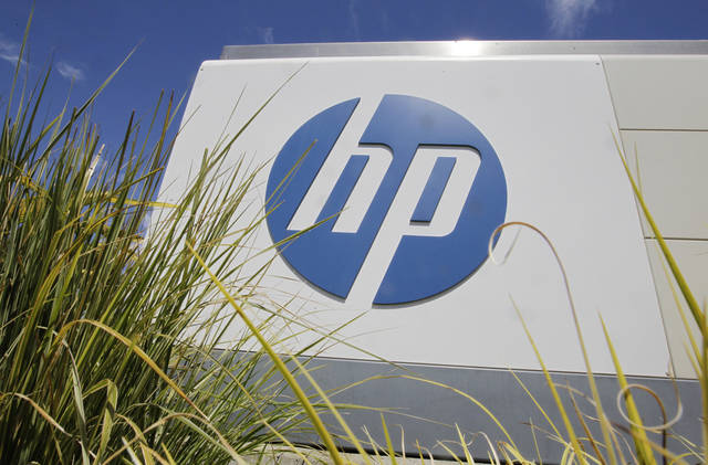 In this Aug. 21, 2012 photo, the Hewlett-Packard Co. logo is seen outside the company's headquarters in Palo Alto, Calif. HP said Autonomy Corporation PLC, a British company it bought for $10 billion last year, lied about its finances, resulting in a massive write-down of the value of the business. HP's net loss for the fiscal fourth quarter, which ended Oct. 31, amounted to $6.85 billion, or $3.49 per share. (AP Photo/Paul Sakuma)