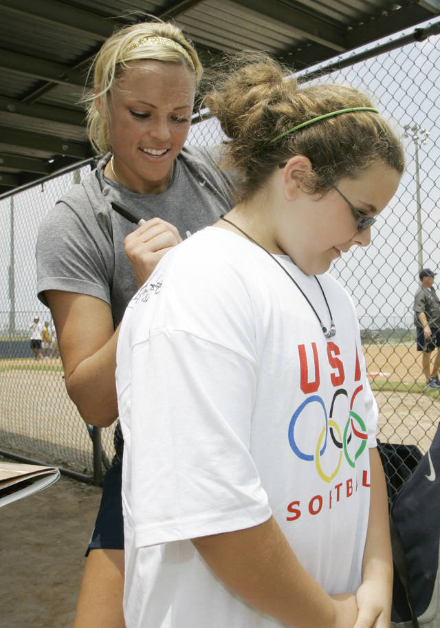 Tori Riley, right, 11, of Weston, W.Va., has her shirt signed by USA softball pitcher Jennie Finch, left, following a team practice in Oklahoma City, Wednesday, July 11, 2007. Fresh off a run to the Canada Cup championship, the U.S. softball team prepares to defend its title at the World Cup of Softball this week in Oklahoma City, the site where coach Mike Candrea recently guided Arizona to its second straight NCAA trophy. (AP Photo)